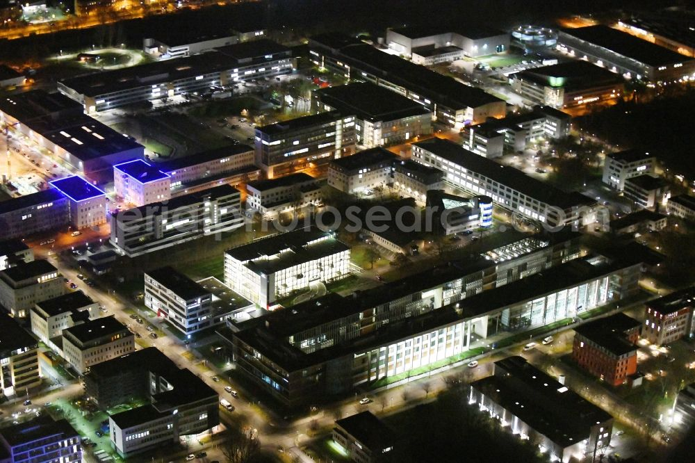 Aerial photograph at night Berlin - Night lighting office building - Ensemble of Scienion AG on Volmerstrasse in the district Johannesthal in Berlin, Germany. Further information at: WISTA-MANAGEMENT GMBH.