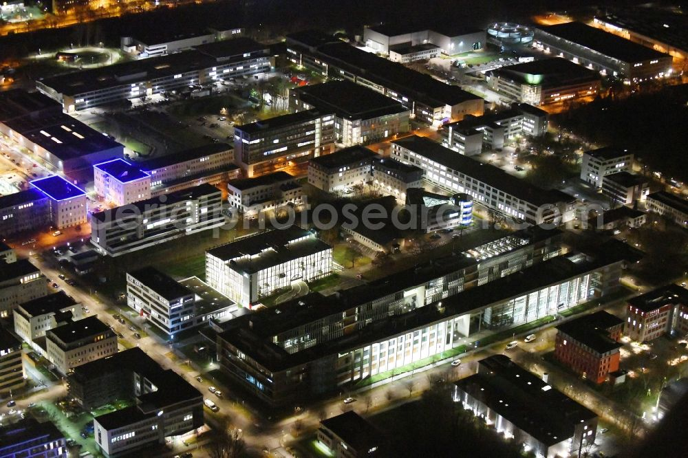 Aerial image at night Berlin - Night lighting office building - Ensemble of Scienion AG on Volmerstrasse in the district Johannesthal in Berlin, Germany. Further information at: WISTA-MANAGEMENT GMBH.