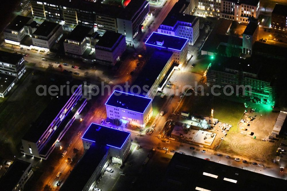 Aerial photograph at night Berlin - Night lighting office building of ARRI Lighting Solutions GmbH in the district Adlershof in Berlin, Germany