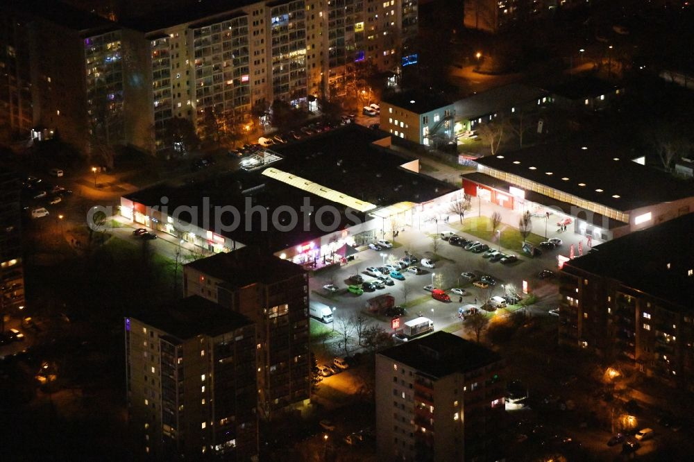 Aerial image at night Berlin - Night lighting building of the shopping center on Hohensaatener Strasse in the district Marzahn in Berlin, Germany. Further information at: PENNY Markt Gesellschaft mit beschraenkter Haftung, REWE Markt GmbH.