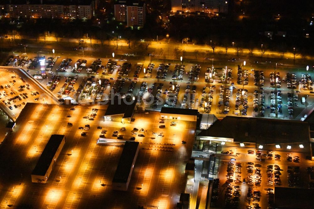 Ahrensfelde at night from above - Night lighting building complex of the shopping center KaufPark Eiche der Unibail-Rodamco Germany GmbH in Ahrensfelde in the state Brandenburg