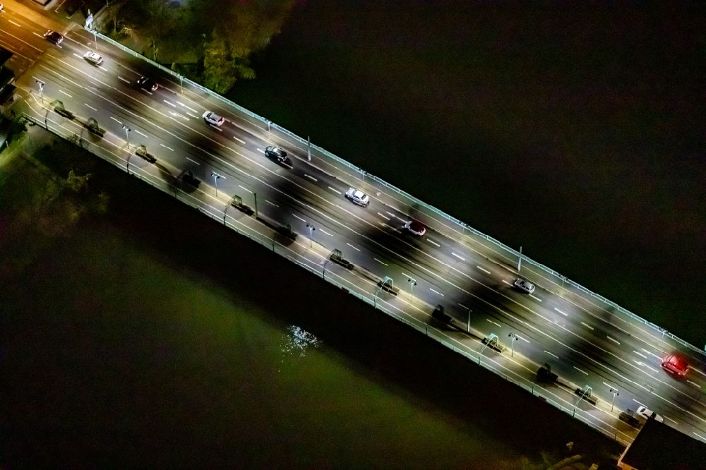 Aerial image at night Mülheim an der Ruhr - Night lighting river - bridge construction Schlossbruecke in Muelheim on the Ruhr in the state North Rhine-Westphalia, Germany