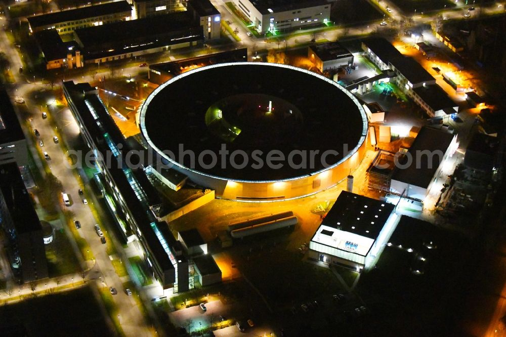 Berlin at night from above - Night lighting research building and office complex Elektronen- Speicherring BESSY - Synchrotronstrahlungsquelle in the district Adlershof in Berlin, Germany