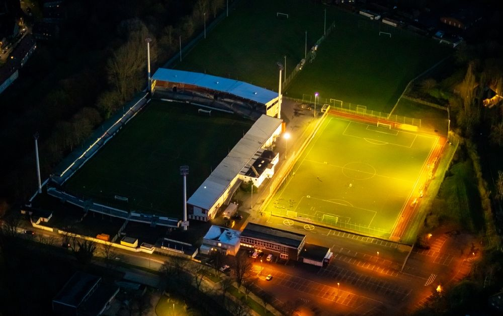 Ahlen at night from above - Night lighting football stadium of the football club Rot Weiss Ahlen e.V. on August-Kirchner-Strasse in Ahlen in the state North Rhine-Westphalia, Germany. Further information at: Rot Weiss Ahlen e.V..