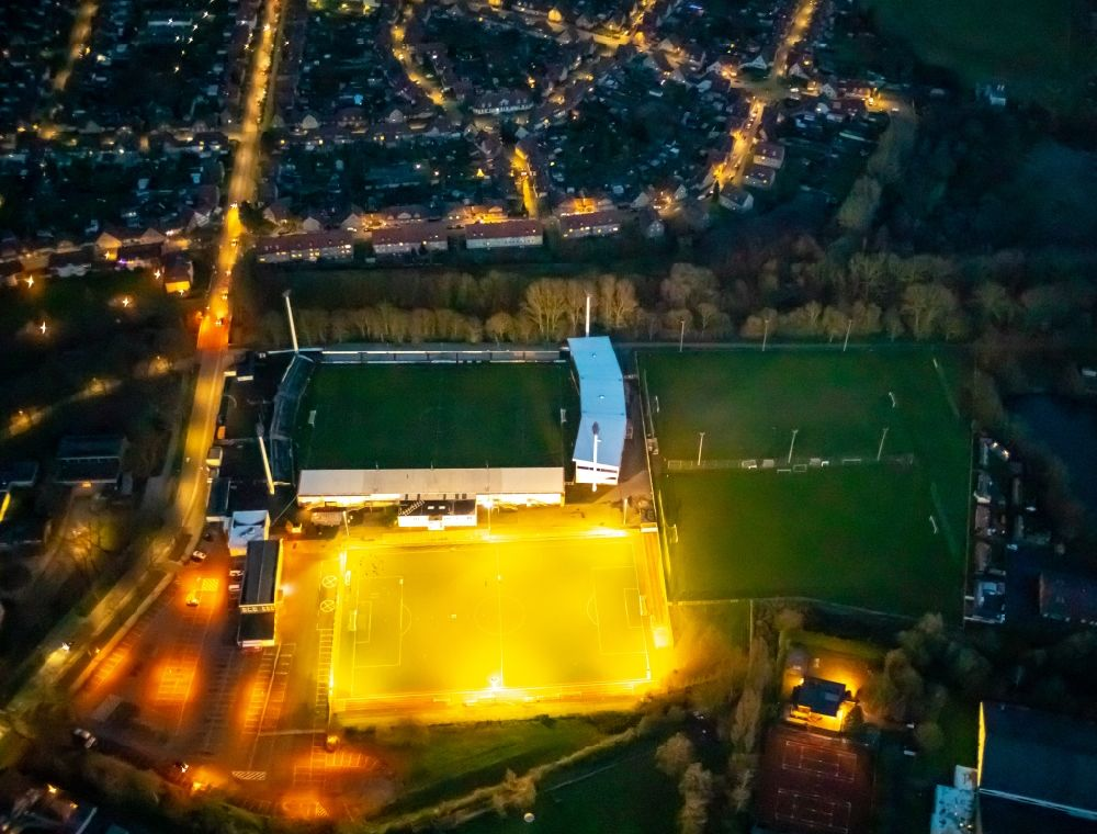Ahlen at night from the bird perspective: Night lighting football stadium of the football club Rot Weiss Ahlen e.V. on August-Kirchner-Strasse in Ahlen in the state North Rhine-Westphalia, Germany
