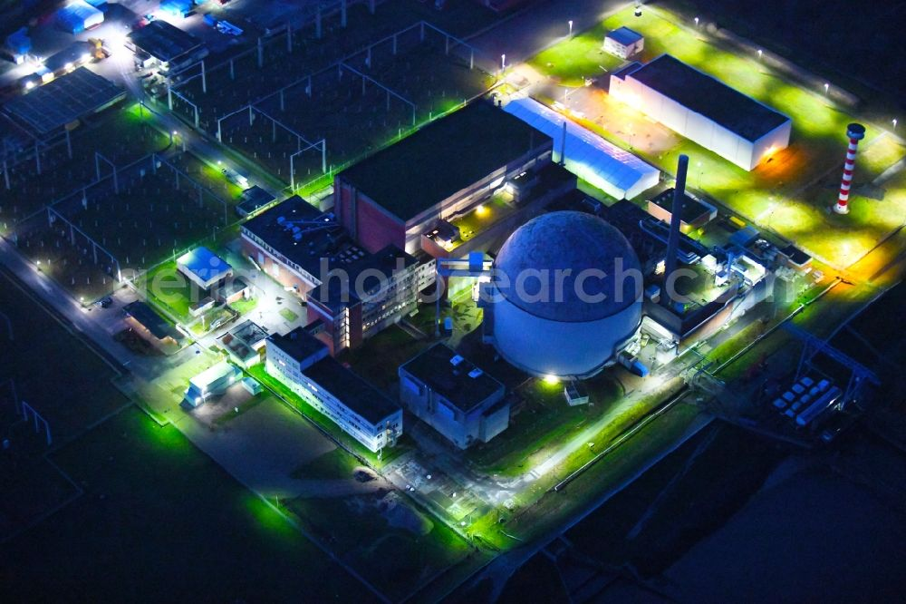 Aerial photograph at night Stade - Night lighting building the decommissioned reactor units and systems of the NPP - NPP nuclear power plant in Stadersand in the state Lower Saxony