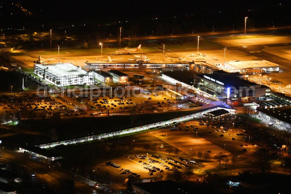 Schönefeld at night from above - Night lighting Runway with hangar taxiways and terminals on the grounds of the airport Berlin-Schoenefeld in Schoenefeld in the state Brandenburg, Germany