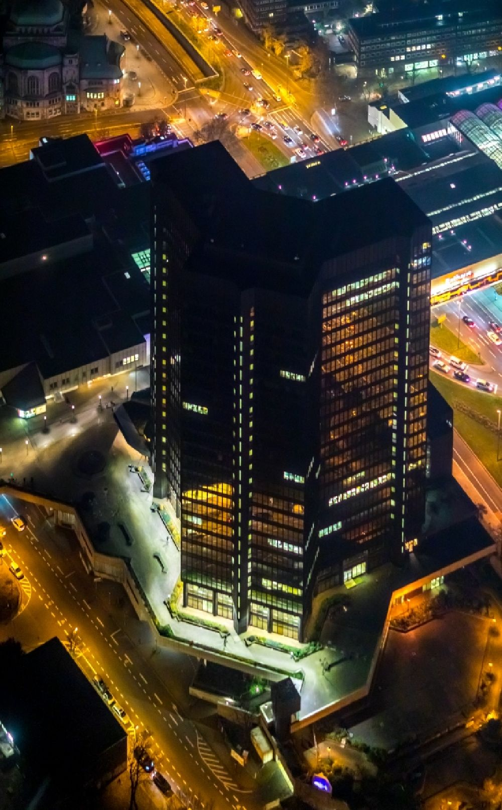 Aerial image at night Essen - Night lighting town Hall skyscraper building of the city administration on Porscheplatz in the district Ostviertel in Essen in the state North Rhine-Westphalia, Germany. Further information at: Stadt Essen, Stadtwerke Essen AG.