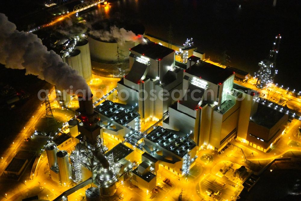 Aerial photograph at night Hamburg - Night lighting power plants and exhaust towers of thermal power station Vattenfall Tiefstack in Hamburg Moorburg, Germany