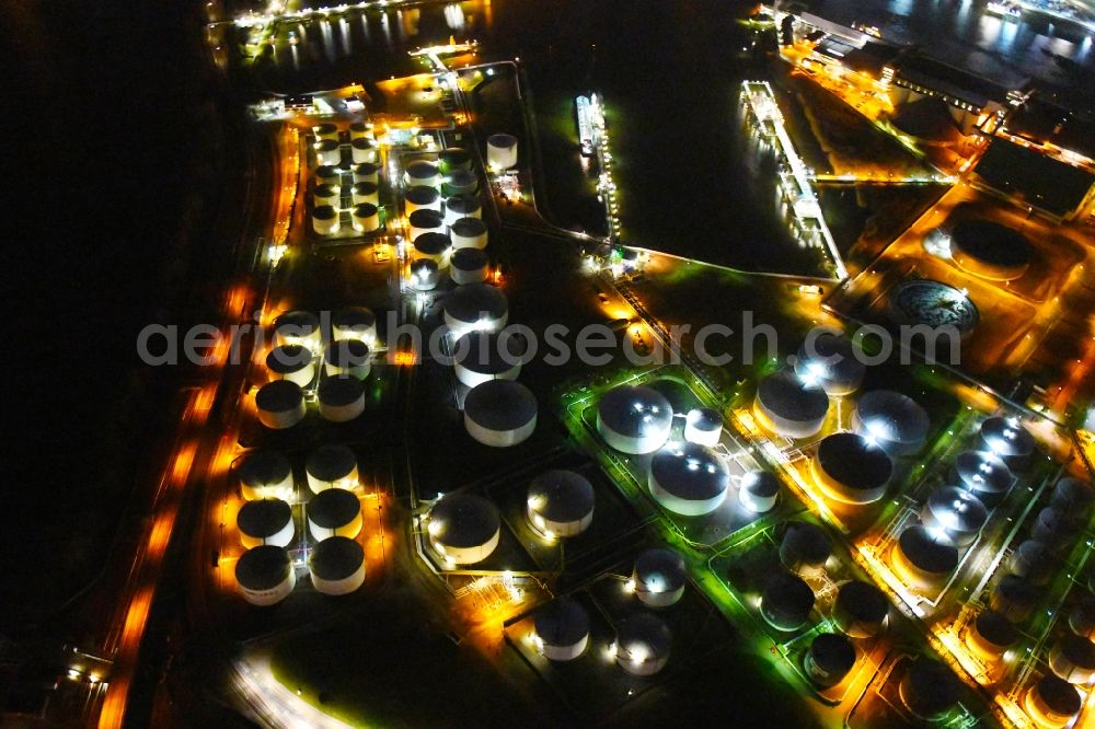 Hamburg at night from above - Night lighting mineral oil - tank Kattwykdamm - Hohe-Schaar-Strasse in the district Wilhelmsburg in Hamburg, Germany. Further information at: HPA Hamburg Port Authority, Oiltanking GmbH.