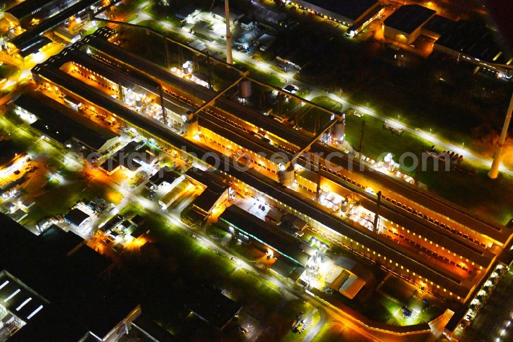 Hamburg at night from above - Night lighting building and production halls on the premises of TRIMET Aluminium SE on Aluminiumstrasse in the district Altenwerder in Hamburg, Germany. Further information at: TRIMET Aluminium SE.