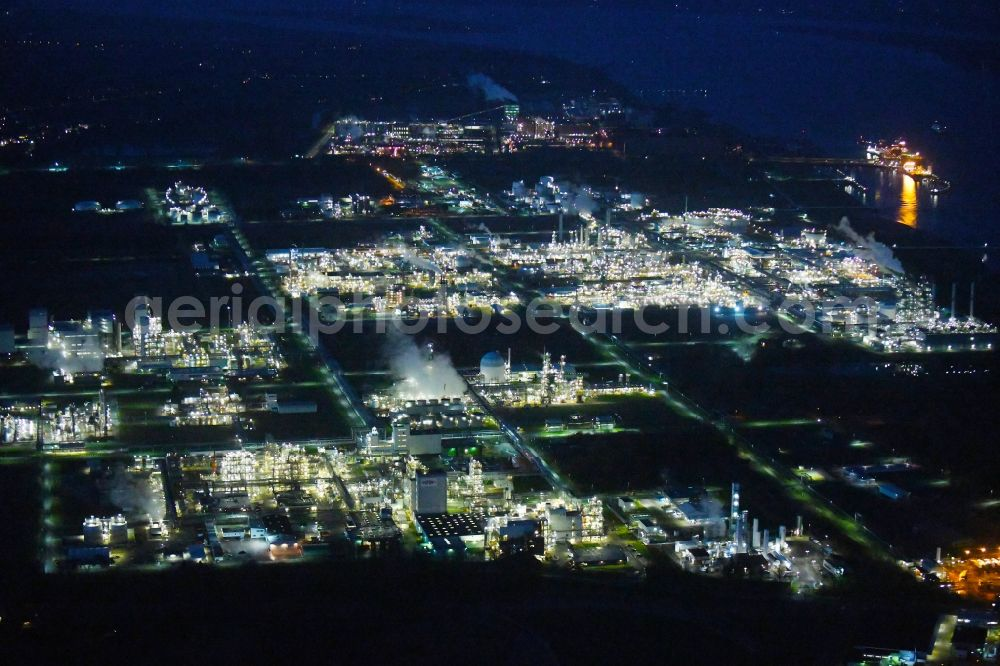 Stade at night from above - Night lighting refinery equipment and management systems on the factory premises of the chemical manufacturers of Fa. Dow Chemical Olin in Stade in the state Lower Saxony, Germany. Further information at: Dow Deutschland Anlagengesellschaft mbH, DuPont Deutschland Holding GmbH & Co. KG, European Energy Exchange AG, ITECS Engineering GmbH.
