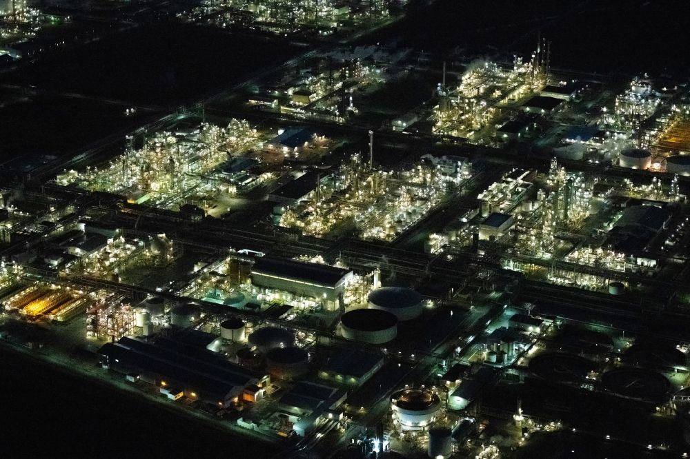 Stade at night from above - Night lighting refinery equipment and management systems on the factory premises of the chemical manufacturers of Fa. Dow Chemical Olin in Stade in the state Lower Saxony, Germany