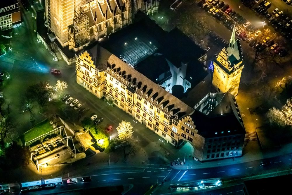 Aerial image at night Duisburg - Night lighting town Salvator church and Hall building of the city administration in Duisburg in the state North Rhine-Westphalia, Germany. Further information at: Evangelischen Kirchengemeinde Alt-Duisburg, Stadt Duisburg, Stadtwerke Duisburg AG.