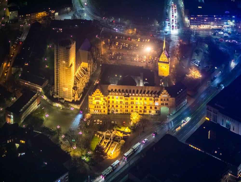Aerial photograph at night Duisburg - Night lighting town Salvator church and Hall building of the city administration in Duisburg in the state North Rhine-Westphalia, Germany