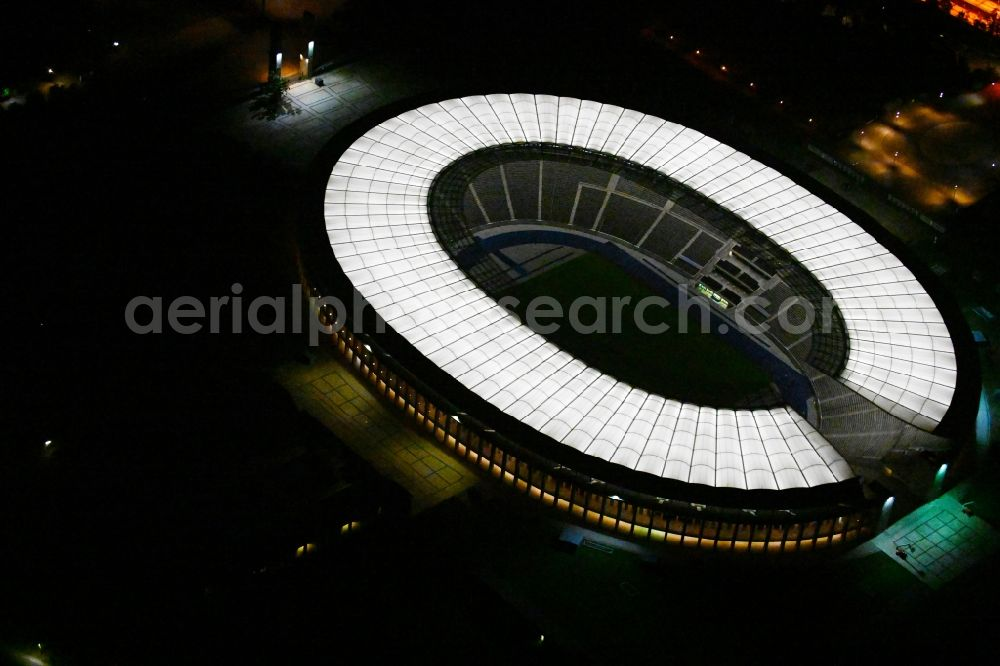 Berlin at night from above - Night lighting sports facility grounds of the Arena stadium Olympiastadion of Hertha BSC in Berlin in Germany