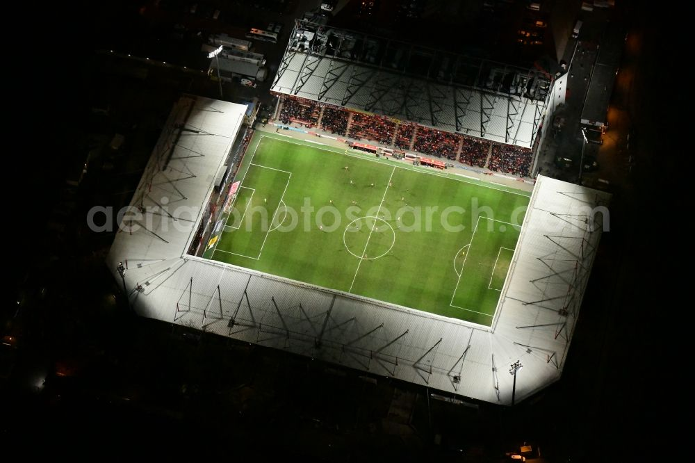 Berlin at night from above - Night lighting view of the football stadium Alte Foersterei with its new grandstand the district of Koepenick in Berlin. The pitch is homestead for the football games of FC Union Berlin