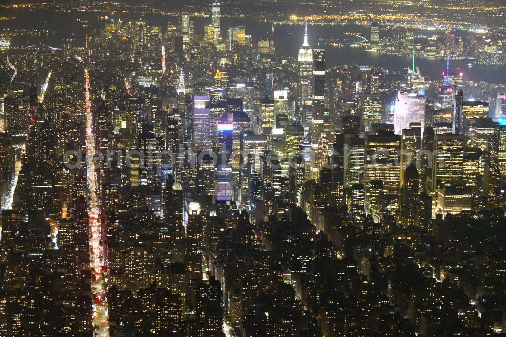 Aerial image at night New York - Night lighting City view of the city area of in the district Manhattan in New York in United States of America