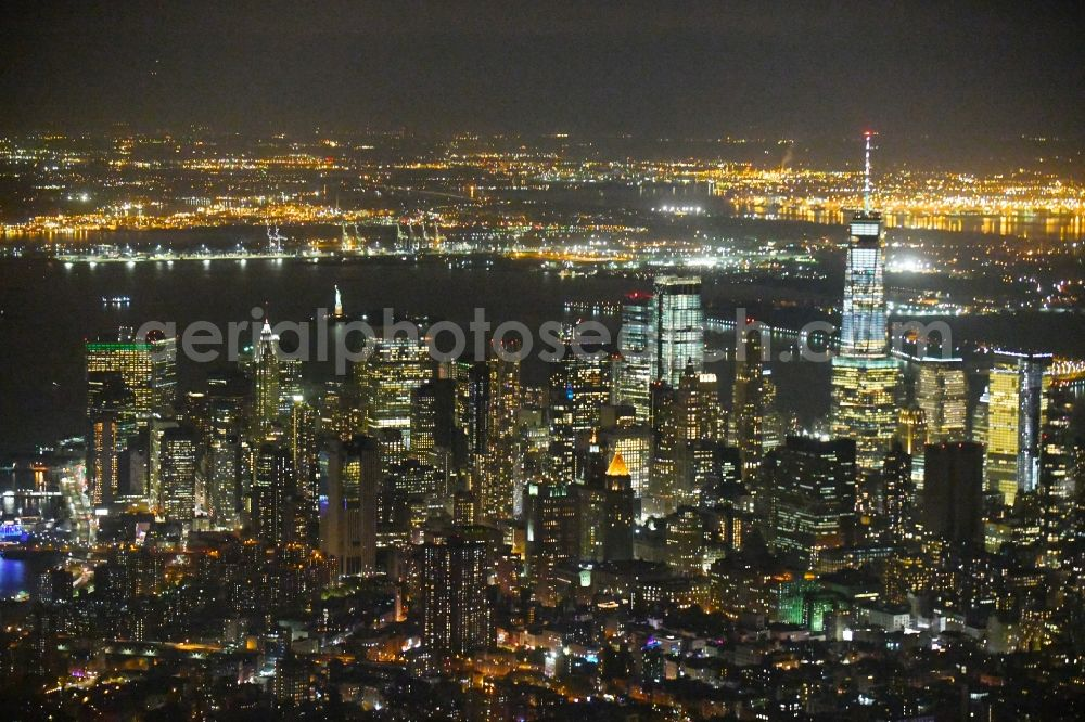 Aerial image at night New York - Night lighting City view of the city area of in the district Manhattan in New York in United States of America.