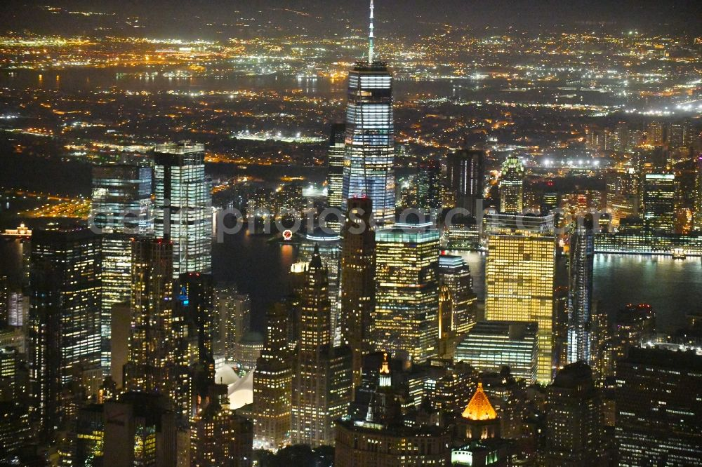 New York at night from the bird perspective: Night lighting City view of the city area of in the district Manhattan in New York in United States of America