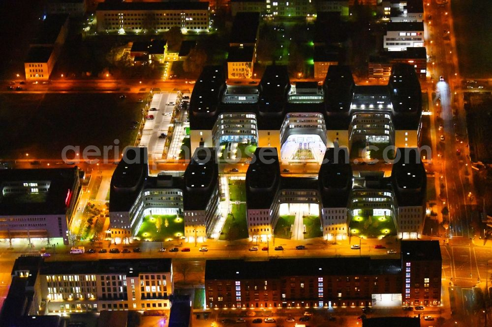 Aerial photograph at night Berlin - Night lighting office and administration buildings of the insurance company Allianz Campus Berlin in the district Adlershof in Berlin, Germany. Further information at: B+G Ingenieure Bollinger und Grohmann GmbH, CORPUS SIREO Asset Management Commercial GmbH, CORPUS SIREO Real Estate GmbH, Drees & Sommer SE, Ed. Zueblin AG, FOM Real Estate GmbH, HPP Architekten GmbH, WISTA-MANAGEMENT GMBH.