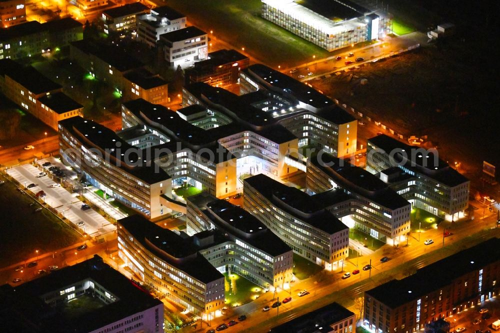 Berlin at night from the bird perspective: Night lighting office and administration buildings of the insurance company Allianz Campus Berlin in the district Adlershof in Berlin, Germany. Further information at: B+G Ingenieure Bollinger und Grohmann GmbH, CORPUS SIREO Asset Management Commercial GmbH, CORPUS SIREO Real Estate GmbH, Drees & Sommer SE, Ed. Zueblin AG, FOM Real Estate GmbH, HPP Architekten GmbH, WISTA-MANAGEMENT GMBH.