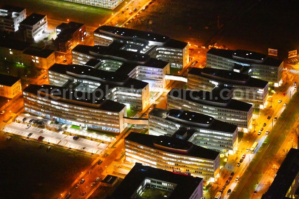 Aerial image at night Berlin - Night lighting office and administration buildings of the insurance company Allianz Campus Berlin in the district Adlershof in Berlin, Germany