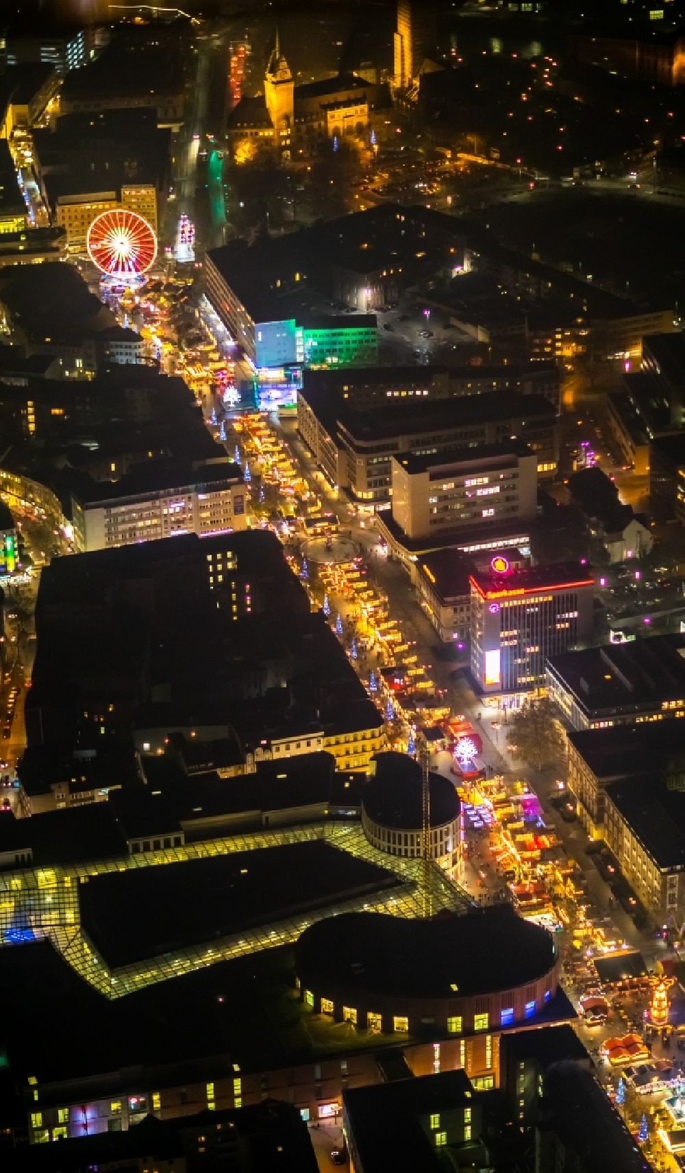 Aerial image at night Duisburg - Night lighting christmassy market event grounds and sale huts and booths auf der Koenigsstrasse in Duisburg in the state North Rhine-Westphalia. In the picture as well the shopping centre Duisburg