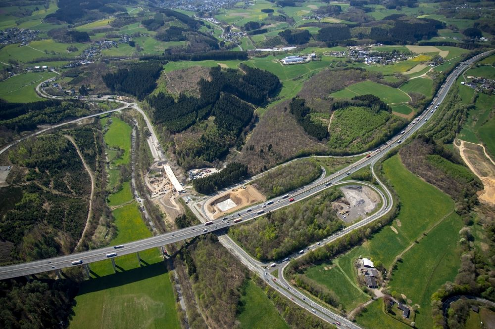 Aerial image Olpe - Construction site of routing and traffic lanes during the highway exit and access the motorway A 45 to the B54 in Olpe in the state North Rhine-Westphalia, Germany