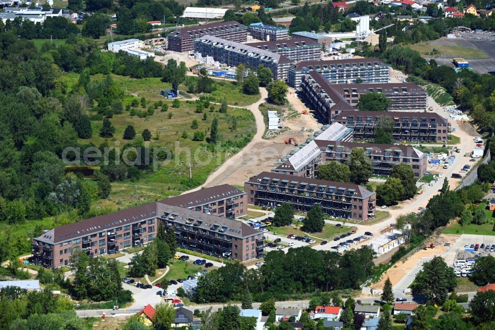 Bernau from the bird's eye view: Construction site for the renovation and reconstruction of the building complex of the former military barracks Sanierungsgebiet Panke-Park on Schoenfelder Weg in Bernau in the state Brandenburg, Germany