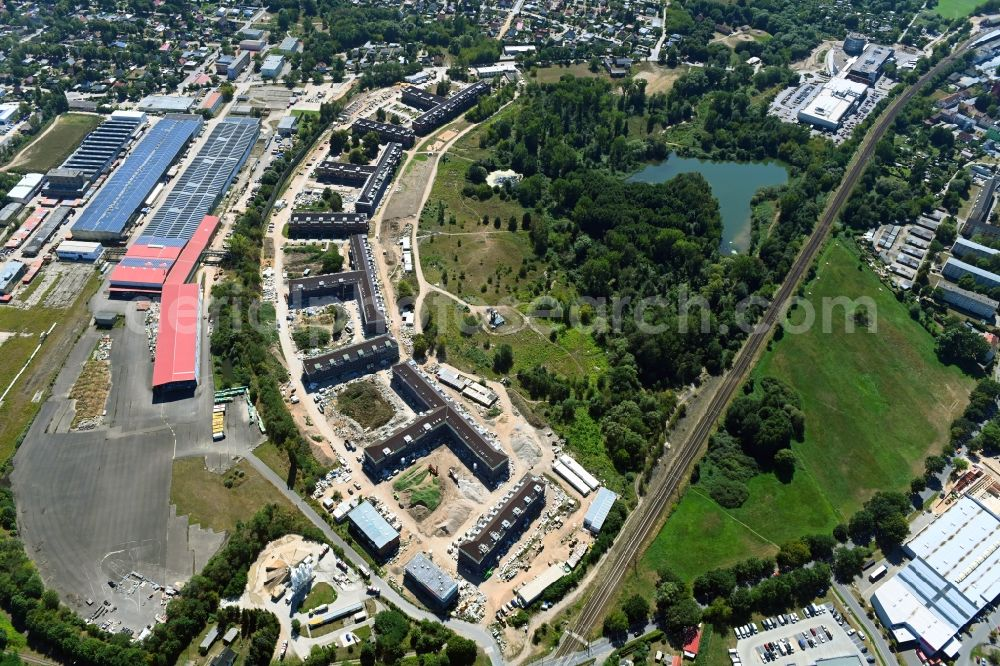 Bernau from above - Construction site for the renovation and reconstruction of the building complex of the former military barracks redevelopment area Panke-Park on Schoenfelder Weg in Bernau in the state Brandenburg, Germany