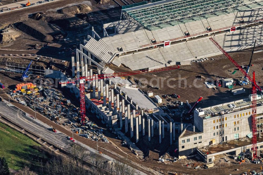 Freiburg im Breisgau from above - Construction site on the sports ground of the stadium SC-Stadion of Stadion Freiburg Objekttraeger GmbH & Co. KG (SFG) in the district Bruehl in Freiburg im Breisgau in the state Baden-Wurttemberg, Germany. The new stadium is next to the airport EDTF
