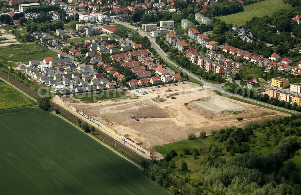 Jena from the bird's eye view: Residential construction site with multi-family housing development- Am Oelste on Leibnizstrasse between the local rail course and B88 in the district Zwaetzen in Jena in the state Thuringia, Germany