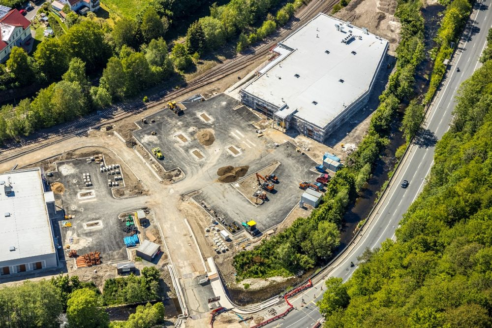 Aerial photograph Lüdenscheid - Construction site for the construction of an Edeka - supermarket and a Trinkgut - beverage market along the Volmestrasse in the district Bruegge in Luedenscheid in the state North Rhine-Westphalia, Germany