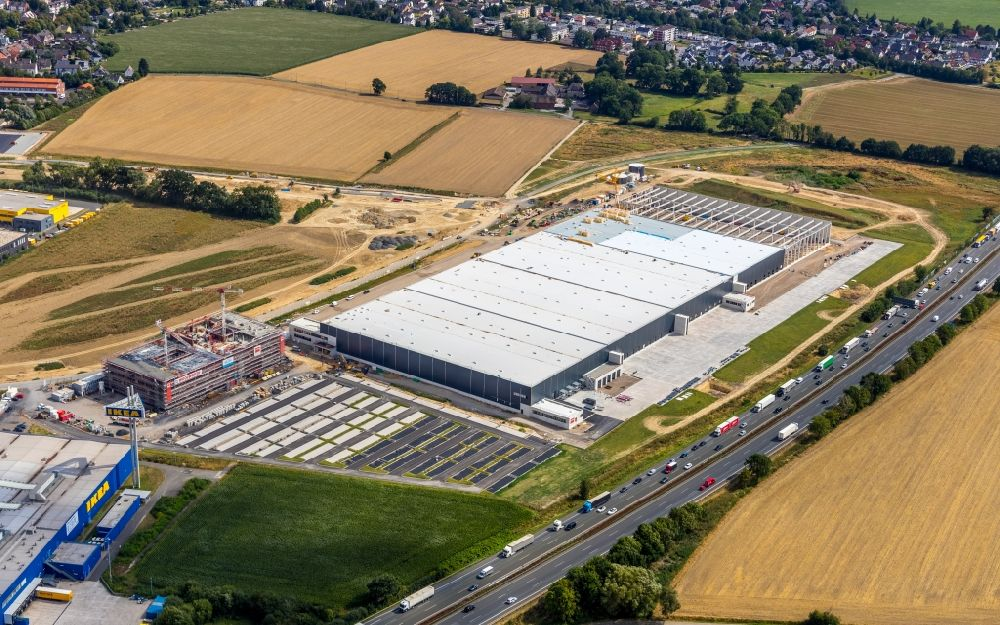 Aerial photograph Kamen - Construction site to build a new building complex on the site of the logistics center of Woolworth GmbH in the district Alte Colonie in Kamen in the state North Rhine-Westphalia, Germany. Further information at: DAL Deutsche Anlagen-Leasing GmbH & Co. KG, DAeLKEN INGENIEURGESELLSCHAFT MBH, Koester GmbH, Woolworth GmbH.