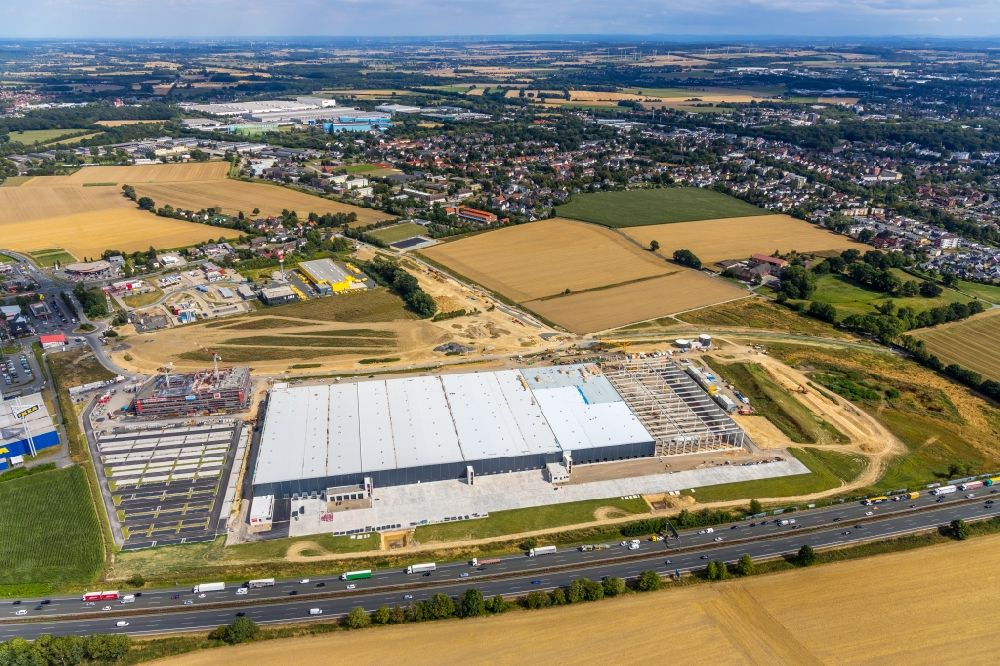Unna from above - Construction site to build a new building complex on the site of the logistics center of Woolworth GmbH in the district Alte Colonie in Kamen in the state North Rhine-Westphalia, Germany. Further information at: DAL Deutsche Anlagen-Leasing GmbH & Co. KG, DAeLKEN INGENIEURGESELLSCHAFT MBH, Koester GmbH, Woolworth GmbH.