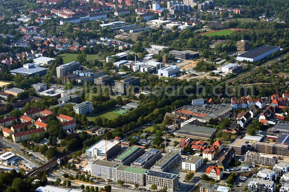 Braunschweig from the bird's eye view: Construction site to build a new multi-family residential complex Quartier Berliner Strasse on Vossenkonp - Otto-Himmel-Weg in the district Wabe-Schunter in Brunswick in the state Lower Saxony, Germany