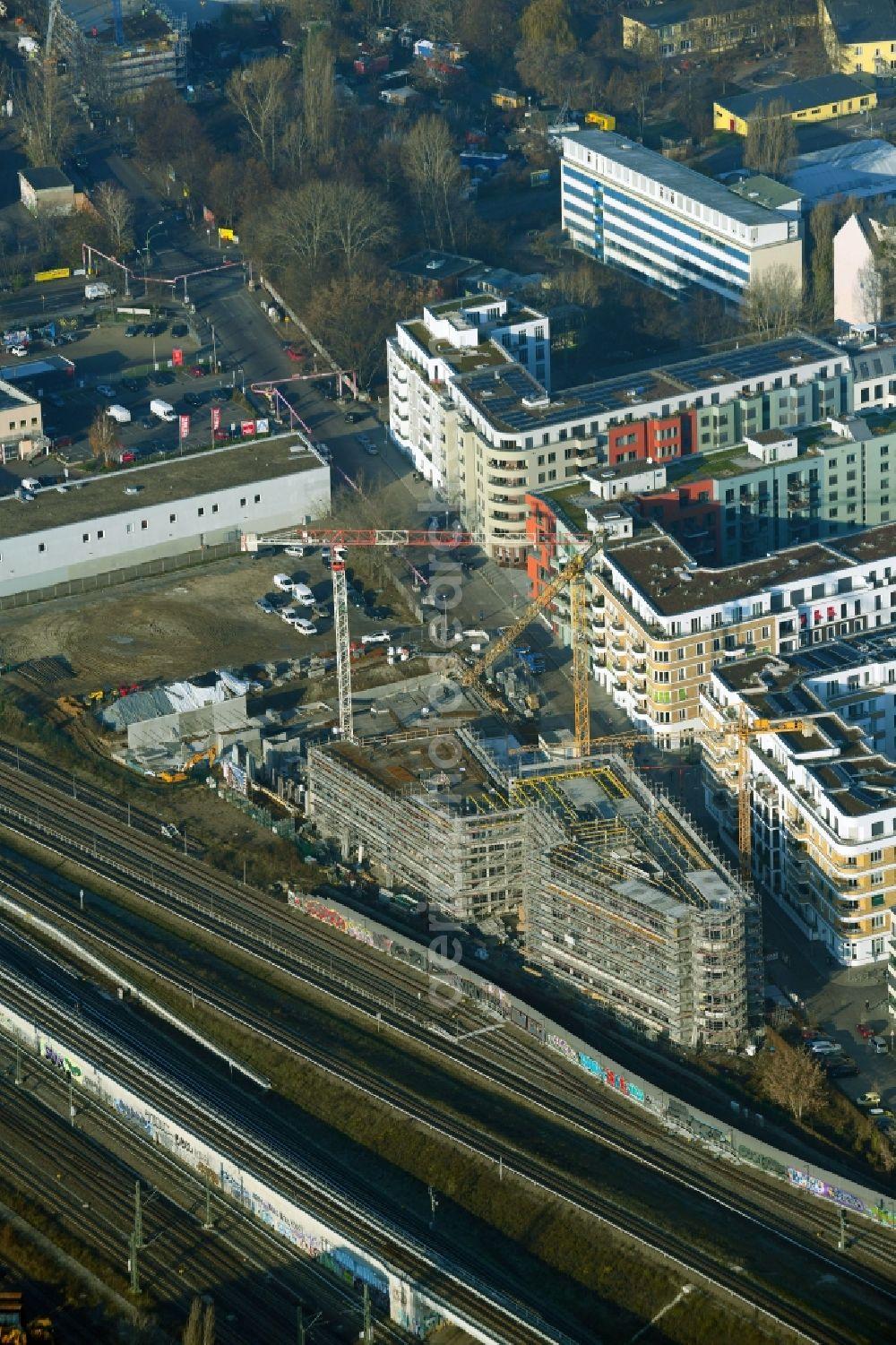 Berlin from the bird's eye view: Construction site for the multi-family residential building Revaler Spitze on Revaler Strasse in the district Friedrichshain in Berlin, Germany