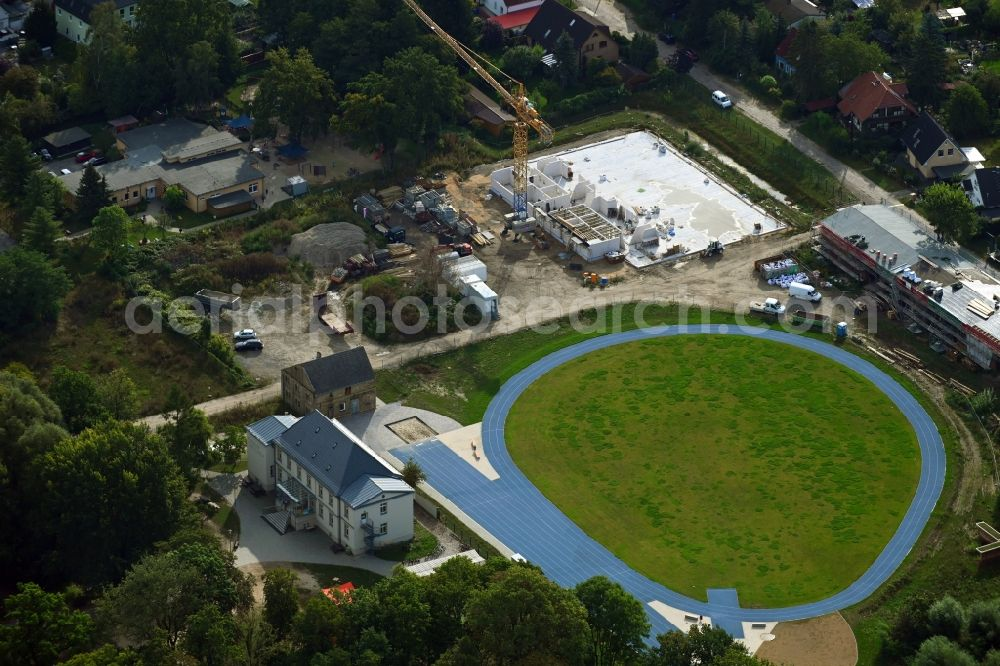 Neuenhagen from above - Construction site for the new construction of a two-field sports hall of the primary school Schwanenteich on Dorfstrasse in Neuenhagen in the state Brandenburg, Germany