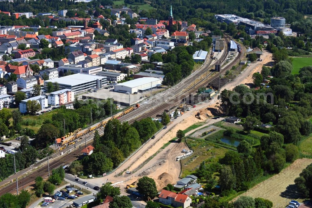Bernau from the bird's eye view: Construction site for the renewal and rehabilitation of the road Ladestrasse - Schwarzer Weg in Bernau in the state Brandenburg, Germany
