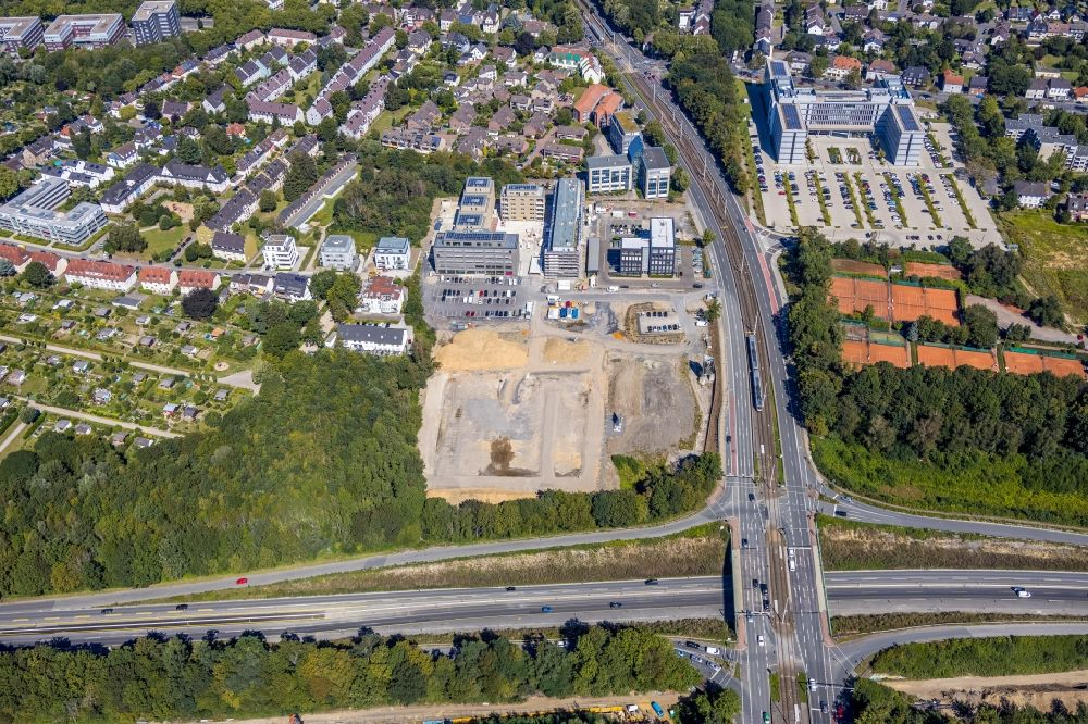 Aerial photograph Bochum - Construction site for the mixed development of residential and commercial space on the Seven-Stones-Areal at Universitaetsstrasse overlooking the Vovonia Unternehmenszentrale in Bochum in the federal state of North Rhine-Westphalia, Germany