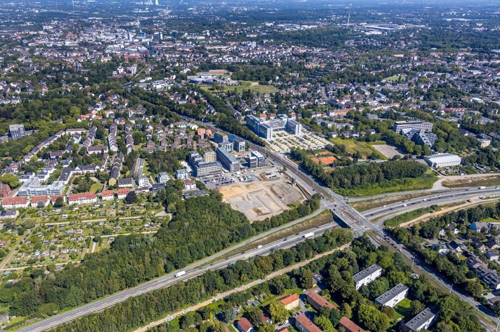 Aerial image Bochum - Construction site for the mixed development of residential and commercial space on the Seven-Stones-Areal at Universitaetsstrasse overlooking the Vovonia Unternehmenszentrale in Bochum in the federal state of North Rhine-Westphalia, Germany