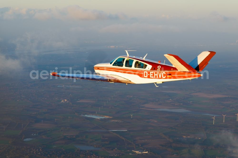 Aerial image Geestland - Beechcraft Bonanza D-EHVC in flight