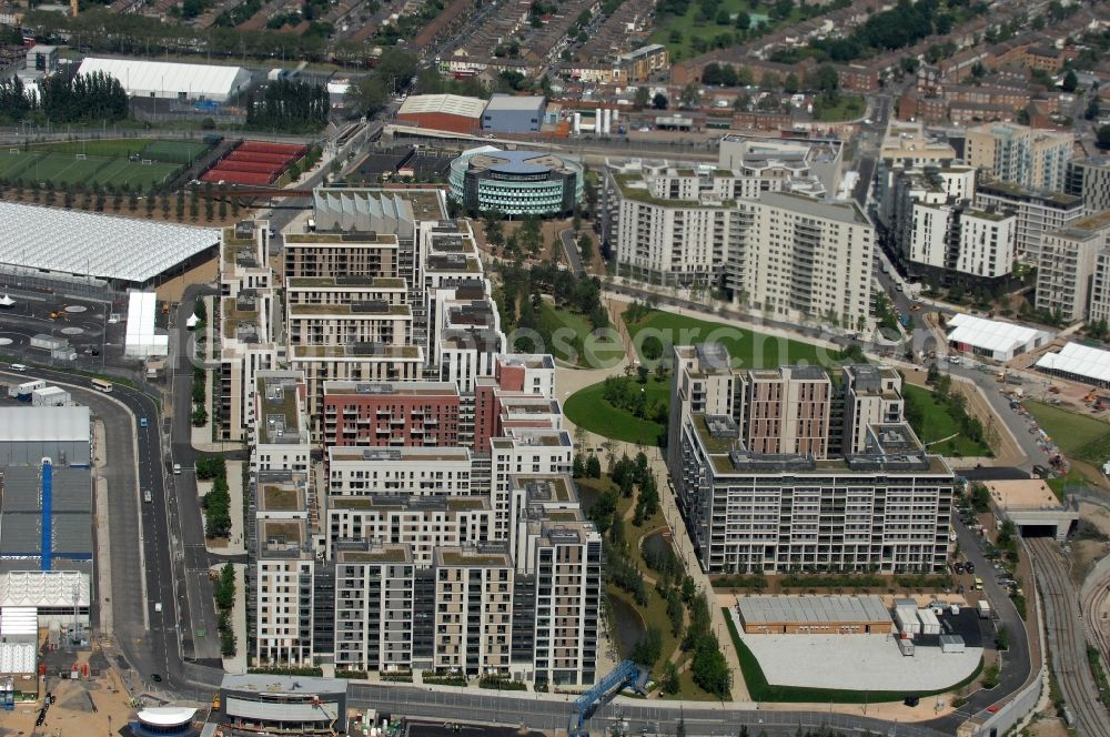 Aerial image London - View at apartment buildings of the Olympic Village at Victory Park in the district Stratford in London in the county of Greater London in the UK. Here all the Olympic athletes were housed. View at apartment buildings of the Olympic Village at Victory Park in the district Stratford in London in the county of Greater London in the UK. Here all the Olympic athletes were housed. Also many sporting and cultural events during the 2012 Olympic Games took place here. Victoria Park is one of the most important historical, public parks in London and one of its oldest. Architects were Caruso St. John, Ian Ritchie, Lifschutz Davidson Sandilands, Rijke Marsh Morgan, DSDHA, Denton Corker Marshall and Eric Parry. For the landscape planning the company Büro Vogt in collaboration with Patel Tylor and Fletcher Priest was responsible.