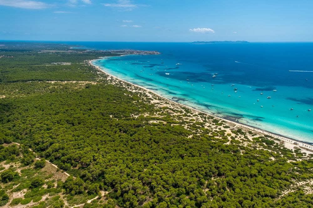 Aerial image Campos - Water surface at the bay along the sea coast of the beach Platja of Trenc in Campos in Islas Baleares, Spain