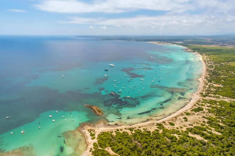 Campos from above - Water surface at the bay along the sea coast of Strands Platja of Trenc in Campos in Islas Baleares, Spain