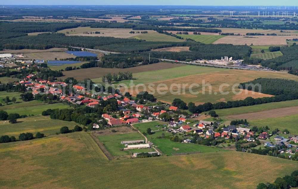 Aerial image Papenbruch - Agricultural land and field borders surround the settlement area of the village in Papenbruch in the state Brandenburg, Germany