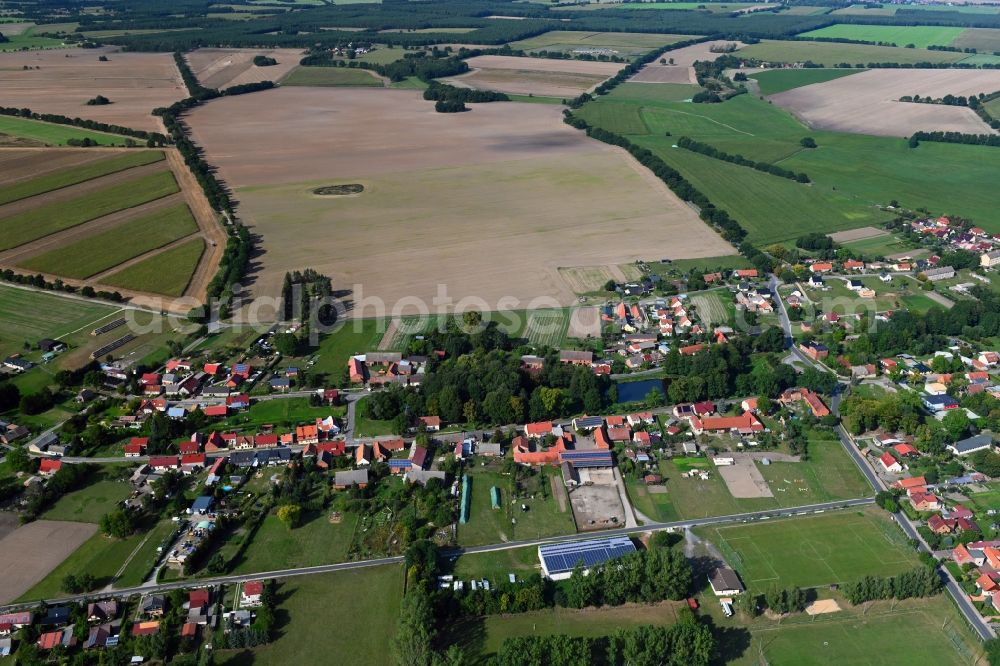 Zaatzke from the bird's eye view: Agricultural land and field borders surround the settlement area of the village in Zaatzke in the state Brandenburg, Germany