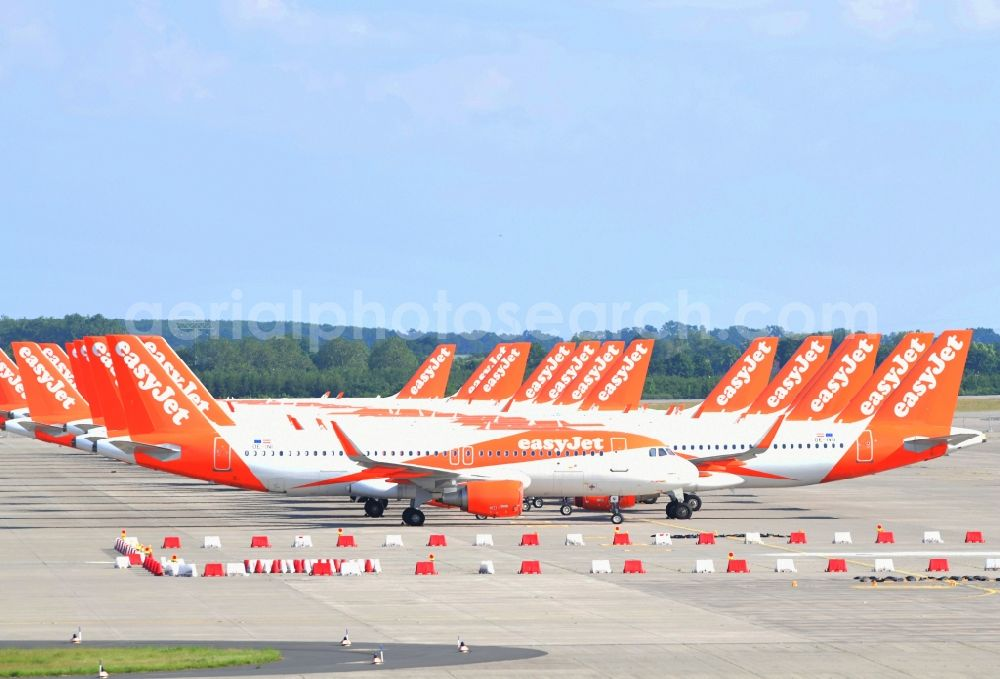 Aerial image Schönefeld - Passenger airplanes of airline easyjet - closed due to crisis - in parking position - parking area at the airport in Schoenefeld in the state Brandenburg, Germany