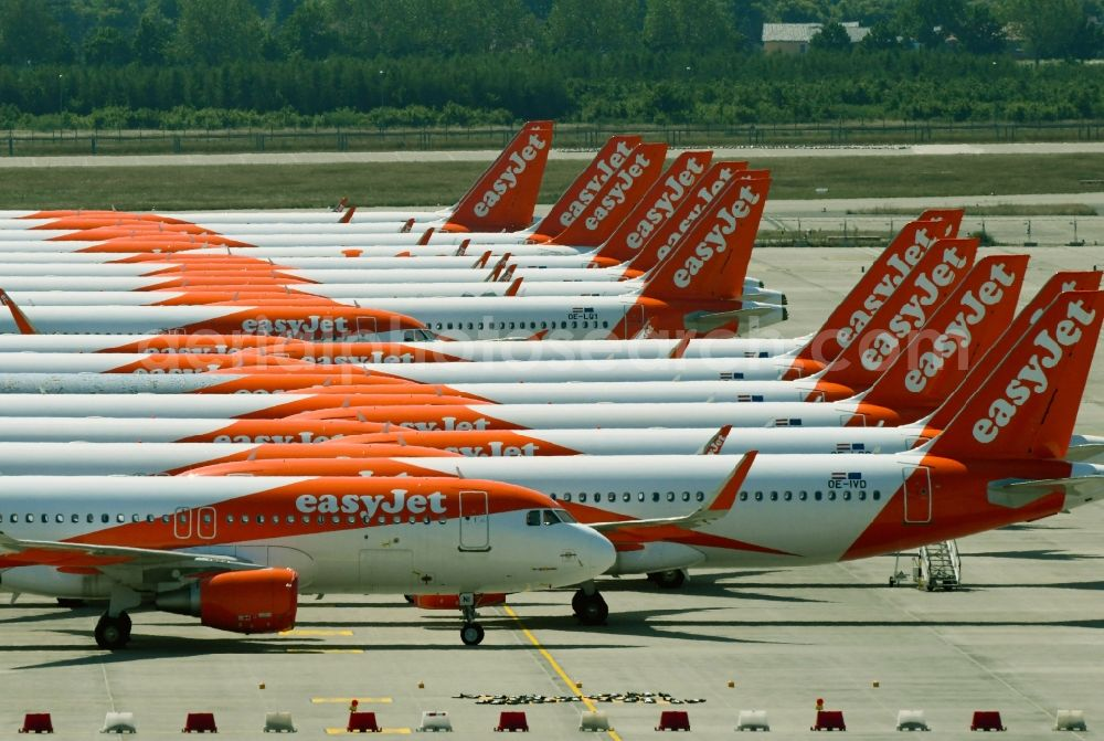 Aerial photograph Schönefeld - Passenger airplanes of airline easyjet - closed due to crisis - in parking position - parking area at the airport in Schoenefeld in the state Brandenburg, Germany